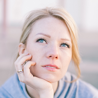 A woman thinking about using hypnosis